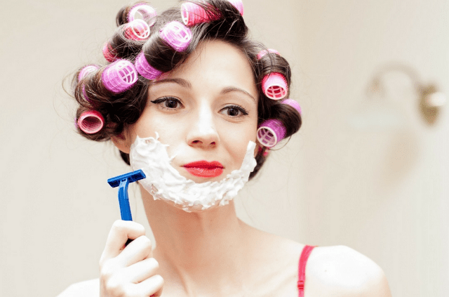 shaving face as a woman